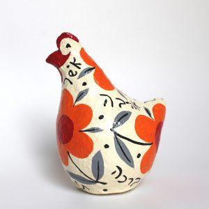 תרנגולת ברכות לבנה עם פרחים כתומים גדולים וברכות בעברית