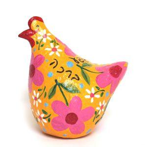 תרנגולת ברכות צהובה עם פרחים צבעוניים וברכות בעברית