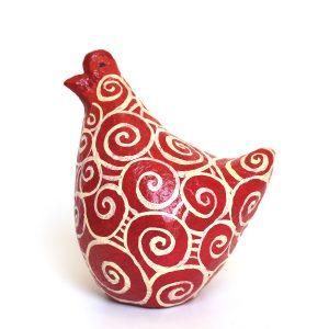 תרנגולת אדומה עם ספירלות לבנות