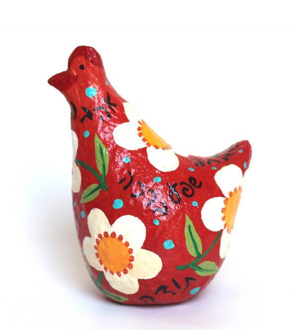 תרנגולת ברכות אדומה עם פרחים לבנים גדולים וברכות בעברית